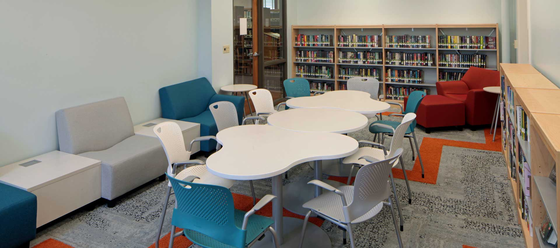 teen room in library with couches, table, chairs